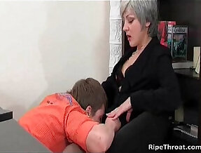 Slutty milf gives a hot blowjob to horny young