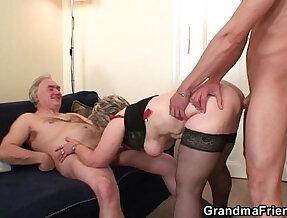 Cock hungry granny enjoys two dicks