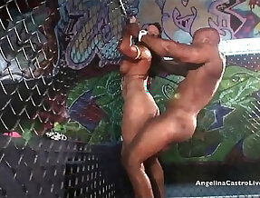 Angelina castro takes on nat turnher big cock in a fighting cage